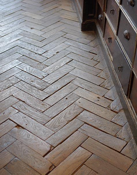 Reclaimed hardwood floor in herringbone pattern.