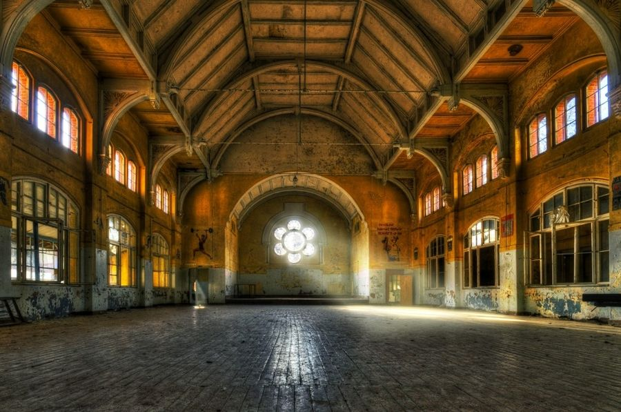 Large, old, orange hall with light and windows. Beelitz
