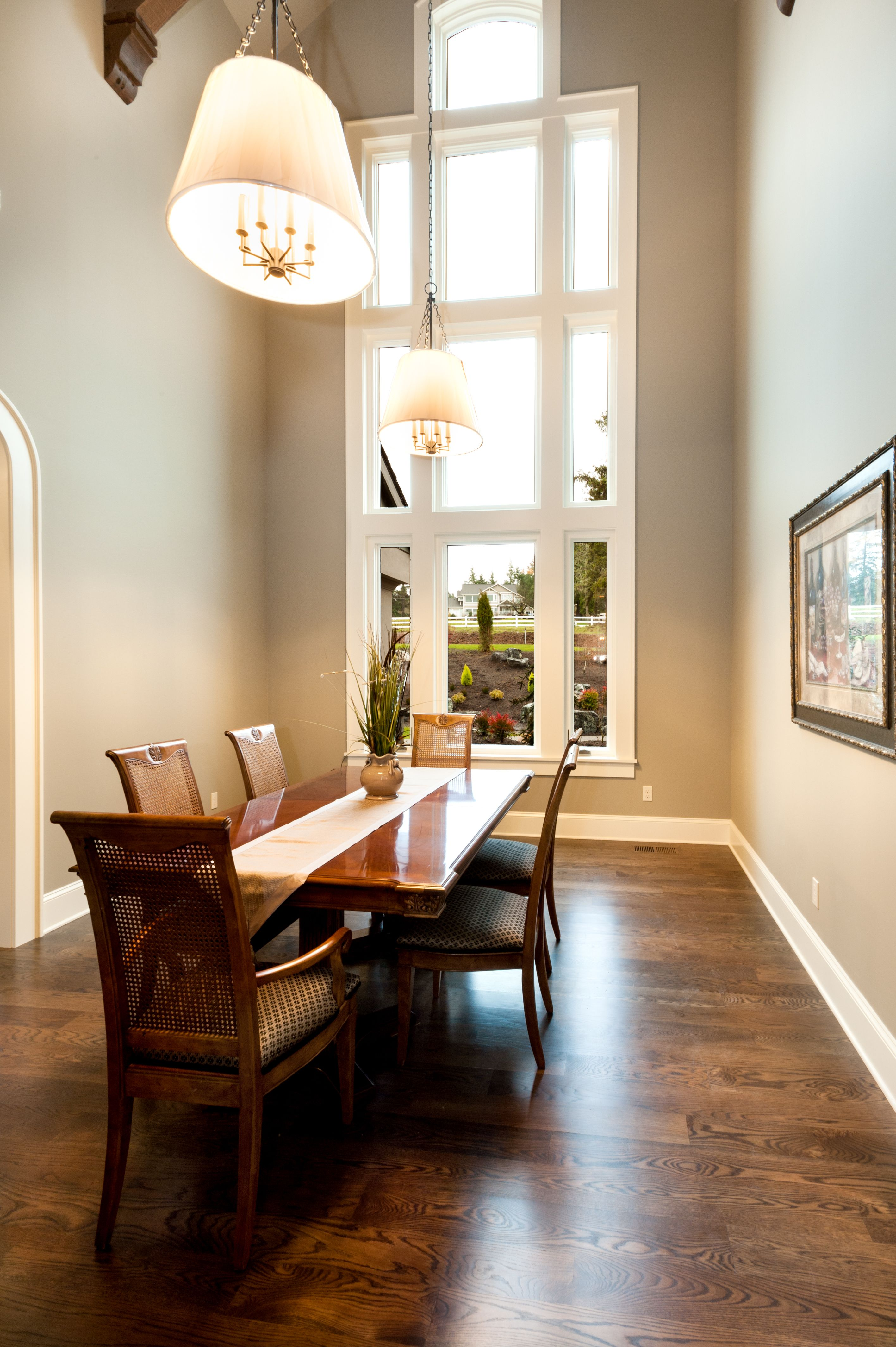 Dining room with white oak floors, white painted trim and