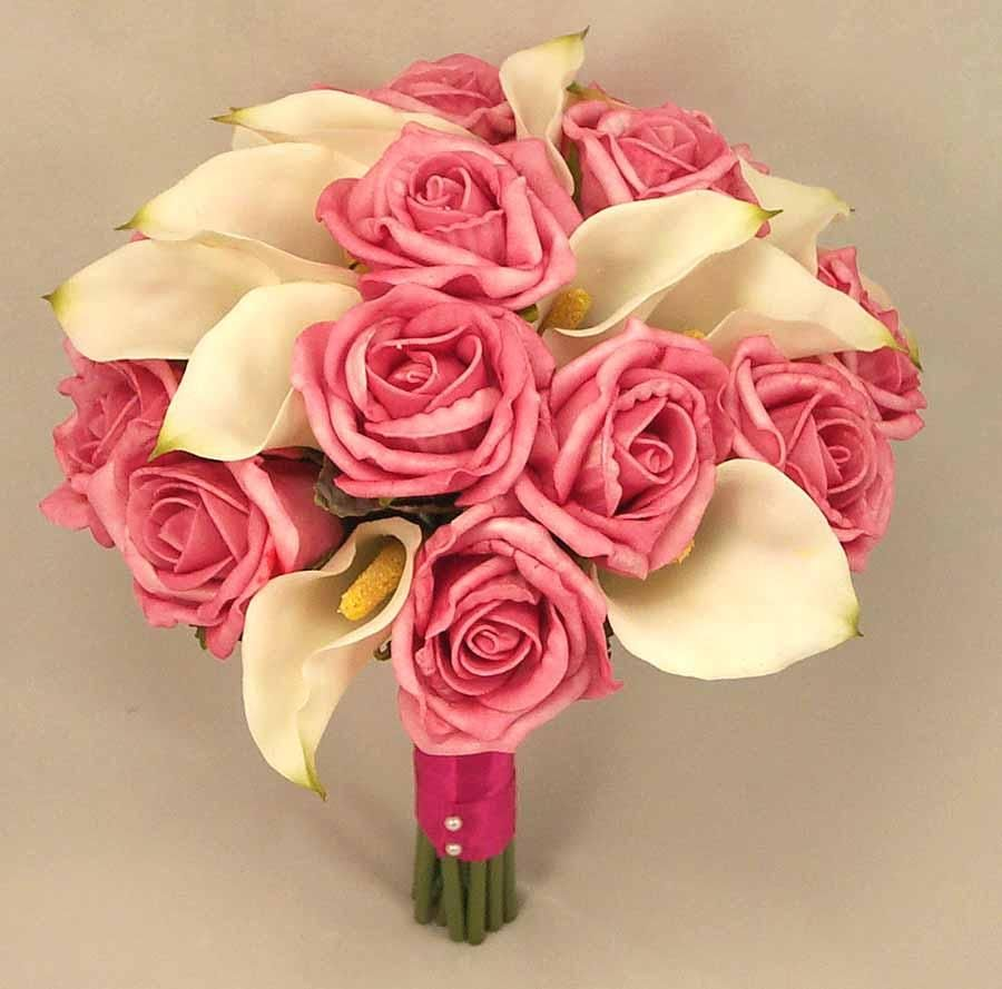 No pink roses but i like the ratio of roses to lilies for my rose wedding bouquets on pink rose bridal bouquets dhlflorist Choice Image