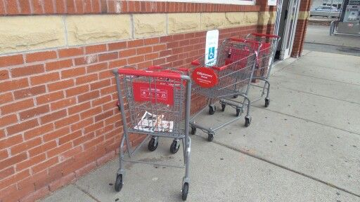 These carts were caught hanging out at the local CVS, with an obvious eye towards understanding what a handicapped parking spot is all about.