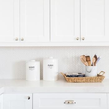 white mini herringbone tile backsplash