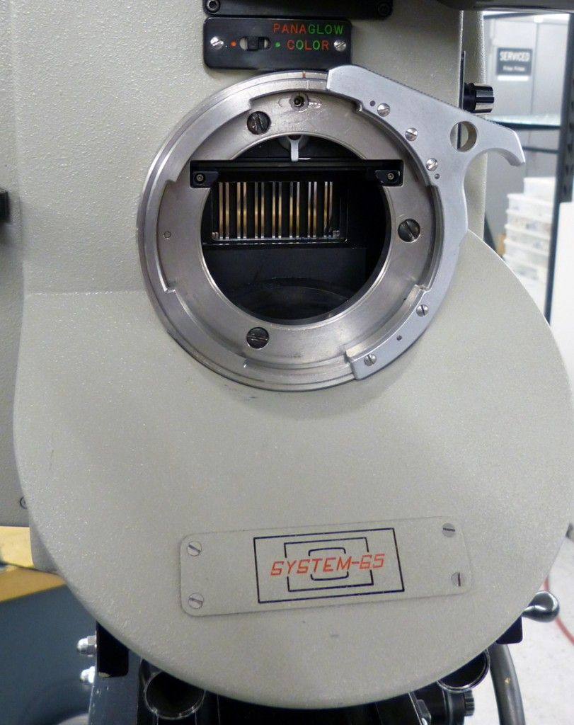 Lens port with room for rotating mirror below