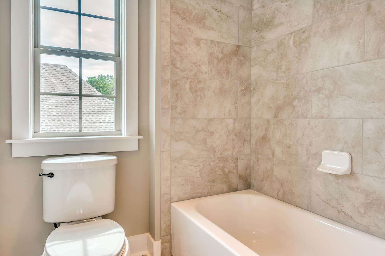 Gorgeous bathroom with tan walls along with a spacious bathtub ...