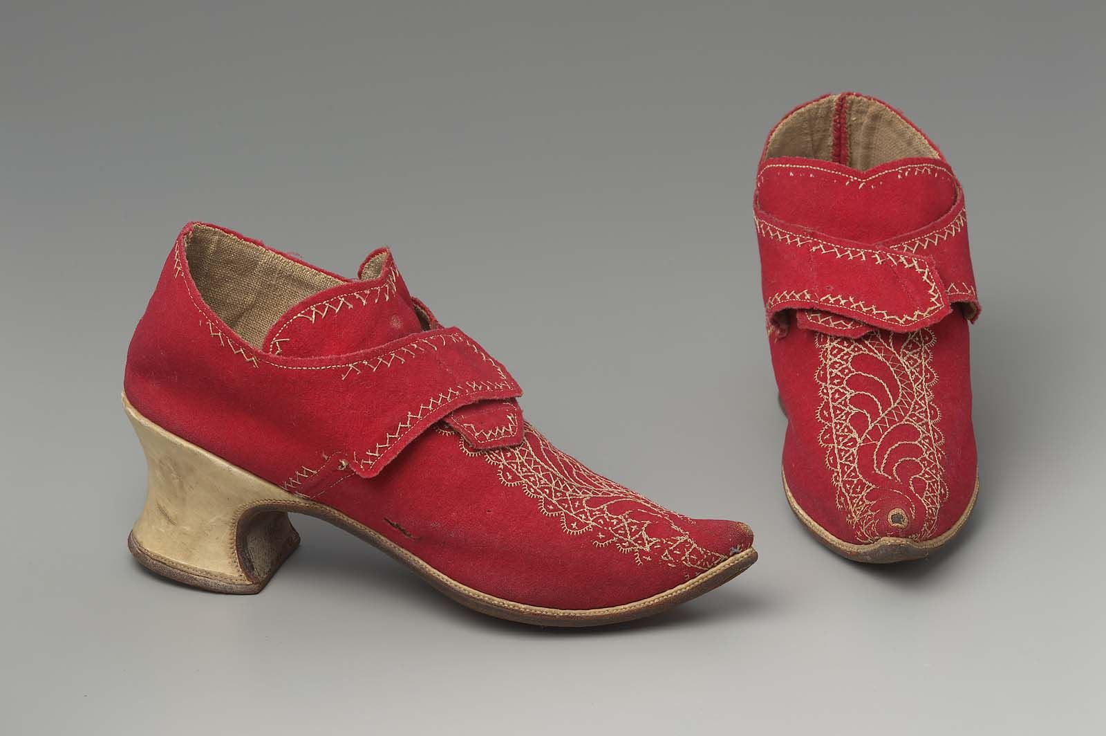 Pair of woman's buckle shoes c1720-40 English Accession Number 44.351a-b Medium or Technique Wool embroidered with silk, linen lining, and leather heel and sole.