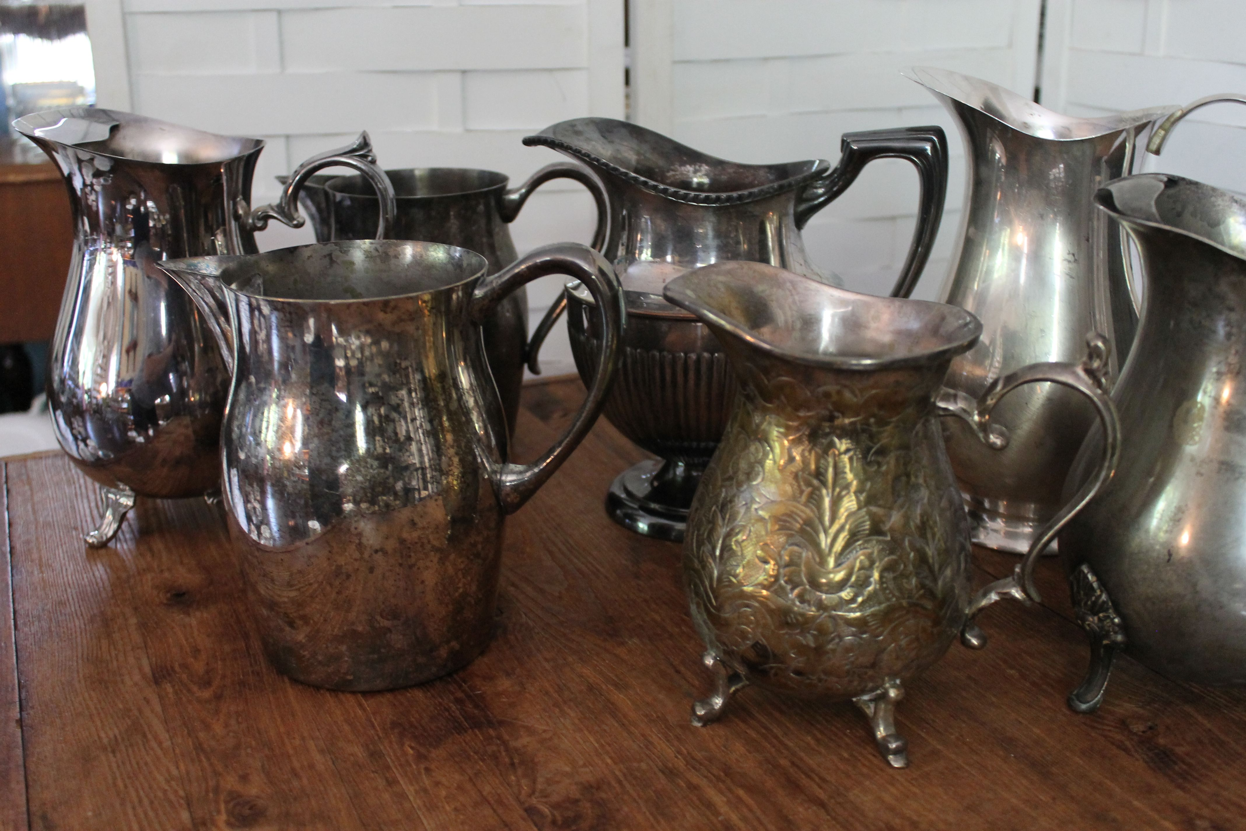 We have 8 large silver pitchers perfect for a vintage wedding or event from Southern Vintage Rental