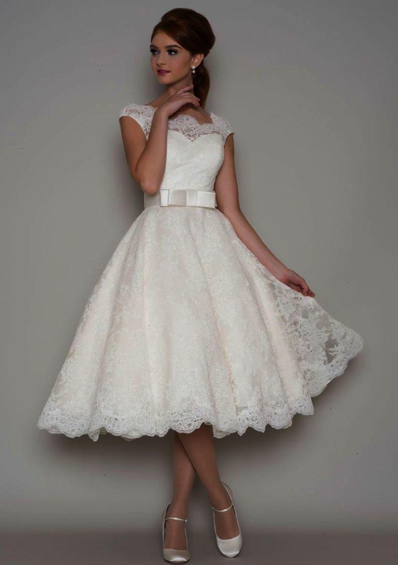 This vintage tea length aline wedding dress features strapless