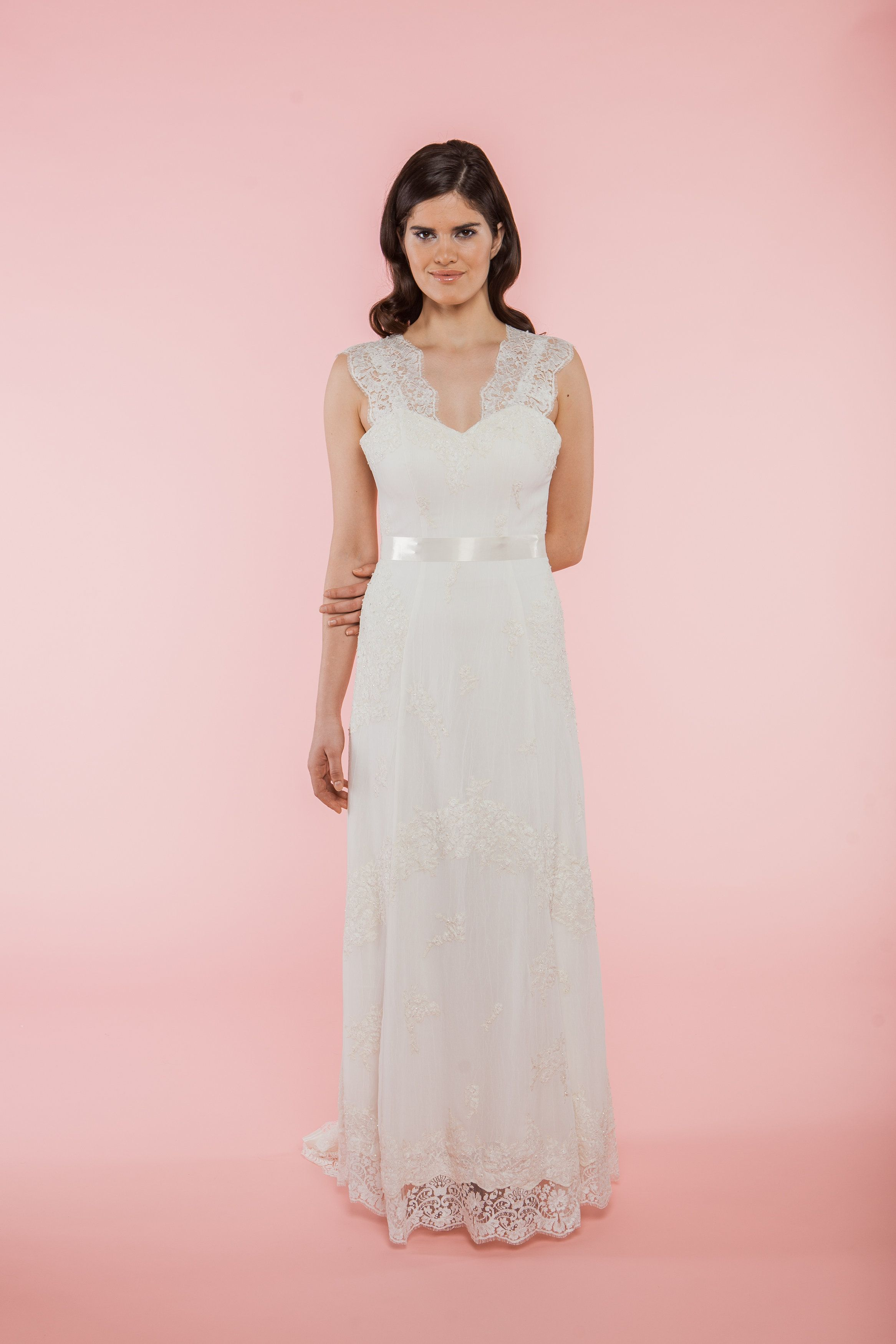 Camilla-Ivory V-neck reconstructed French lace applique and Swarovski crystal A-line Gown.
