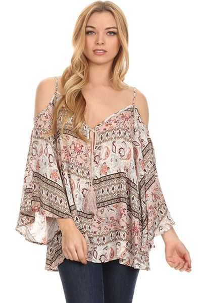 Bohemian fashion takes center stage in this cold shoulder bohemian blouse