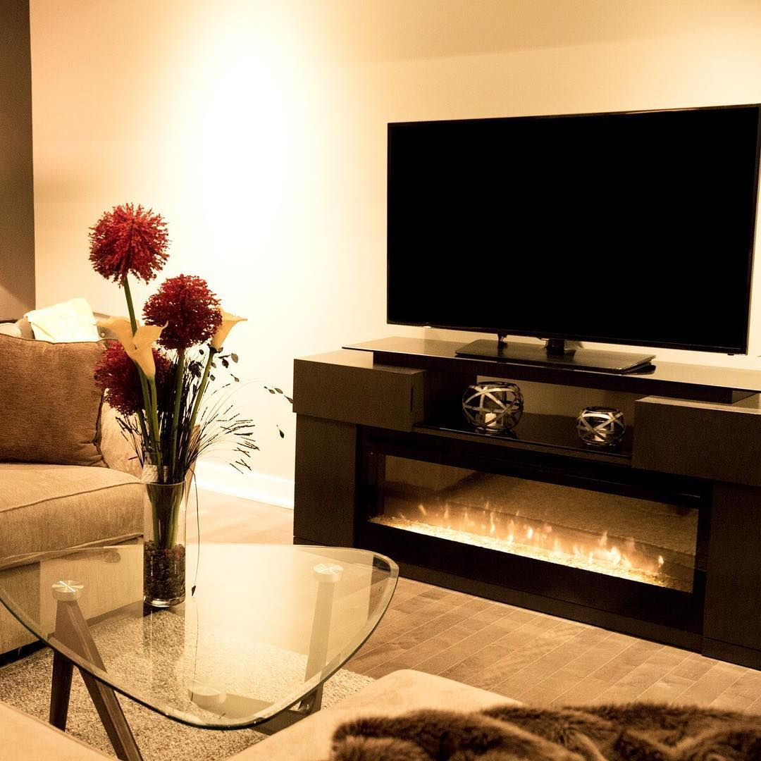 Créez une ambiance cocooning au salon avec un feu de foyer à même ...