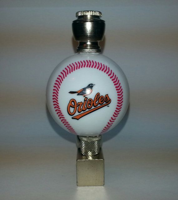 """Baltimore Orioles Baseball Pipe, Fully Functional Wedge Smoking Pipe. Brass  Finish, Colorful Red Acrylic Stem, Large Bowl with Bowl cover, Chamber section (section size varies). Securely attached 2"""" diameter Baltimore Orioles logo baseball. This novelty item can also be displayed as decorative collectible on any desk or table top.    All MLB teams are available and in stock    All products Published on this site are TRADITIONALLY DESIGNED AND INTENDED legal TOBACCO use.   As the consumer it…"""