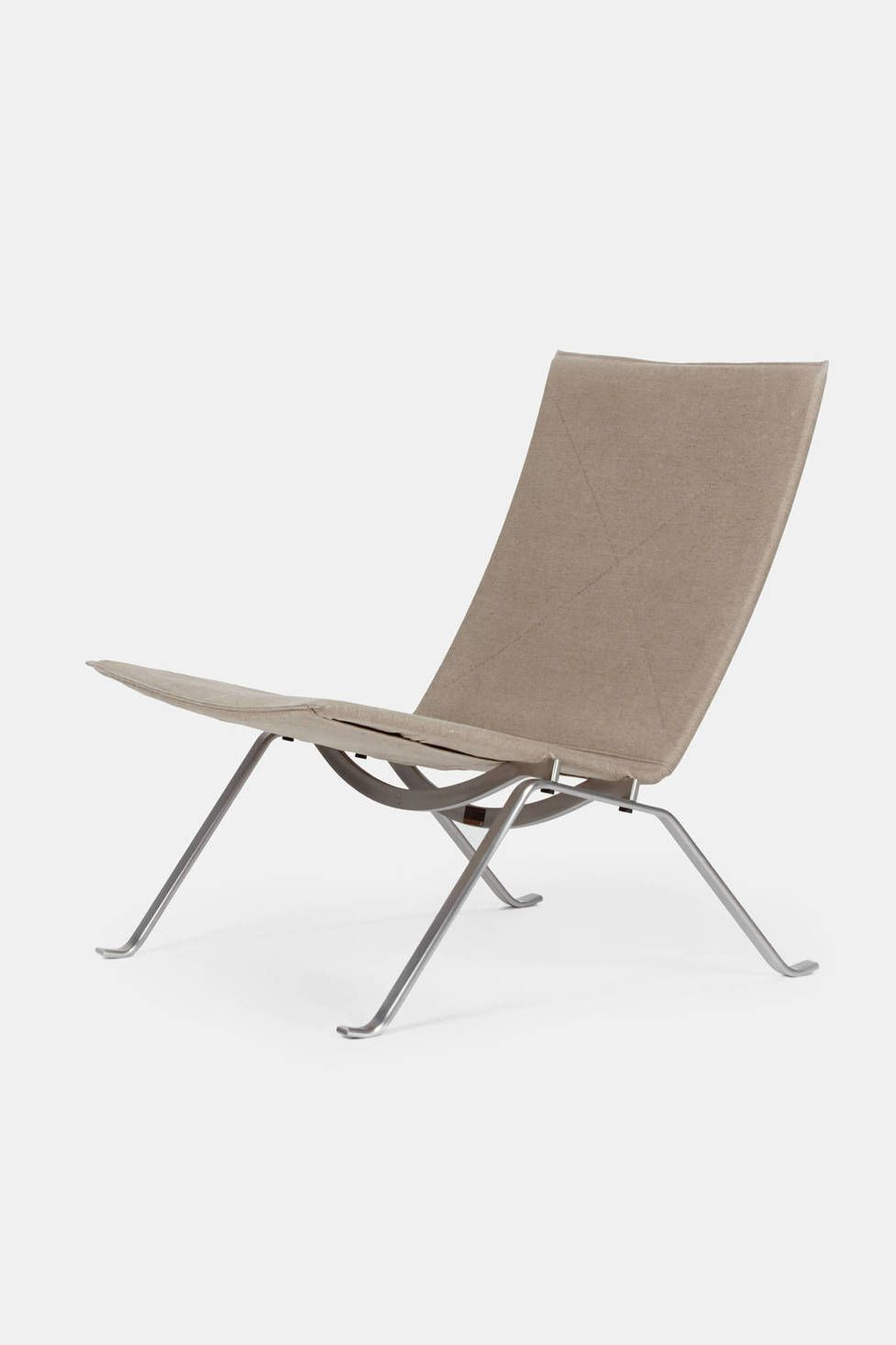 "Upholstered in natural canvas, this elegant lounge chair epitomizes the work of Poul Kjærholm and his search for the ideal form and industrial dimension. The profile of the steel frame originates from his graduation project, the ""Element"" Chair (PK25), at the School of Applied Arts in Copenhagen. In 1957, the PK22 was awarded the Grand Prix at the Milan Triennale, a prize that catapulted Kjærholm onto the international design scene."