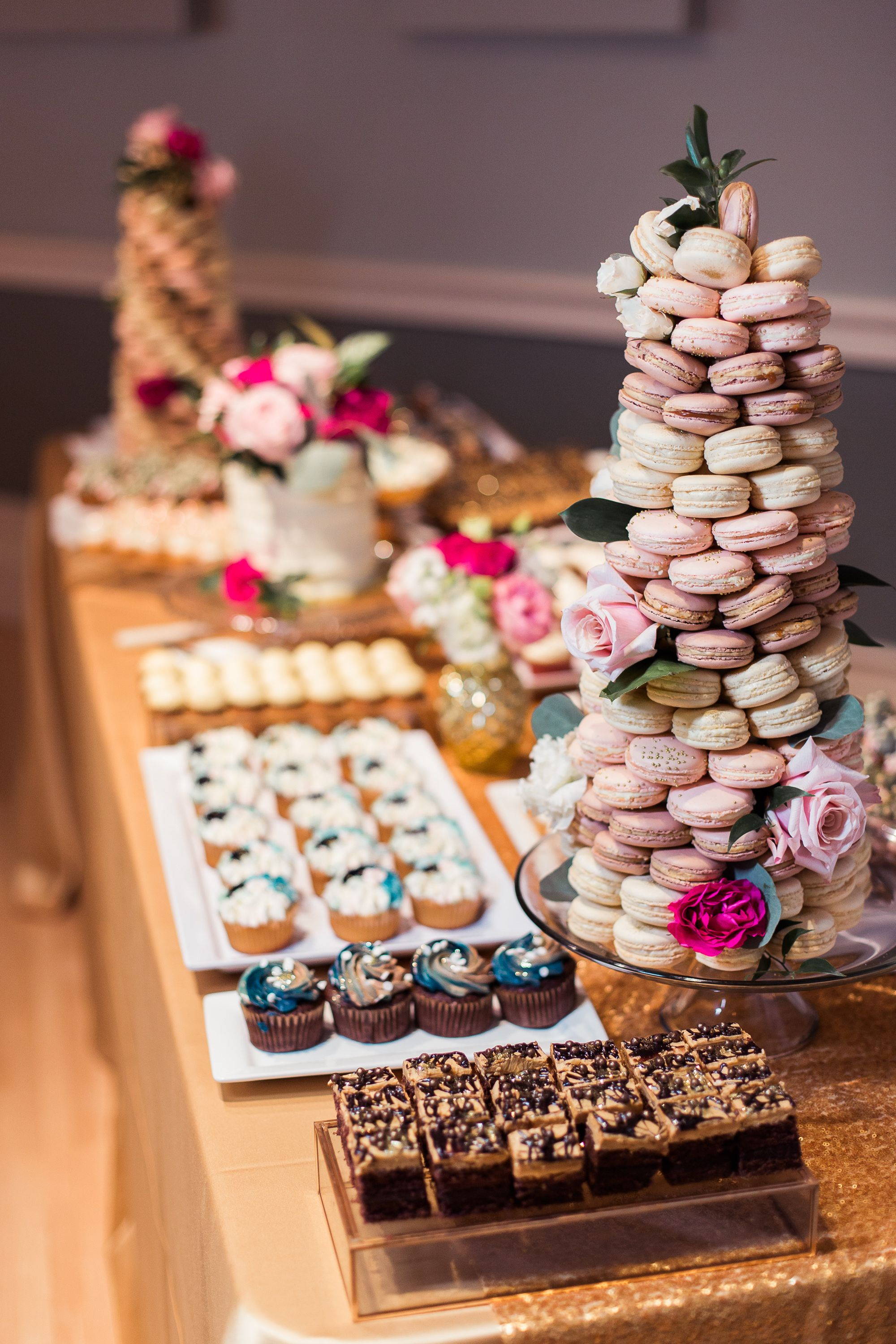 Decked out dessert table with different platters and cake