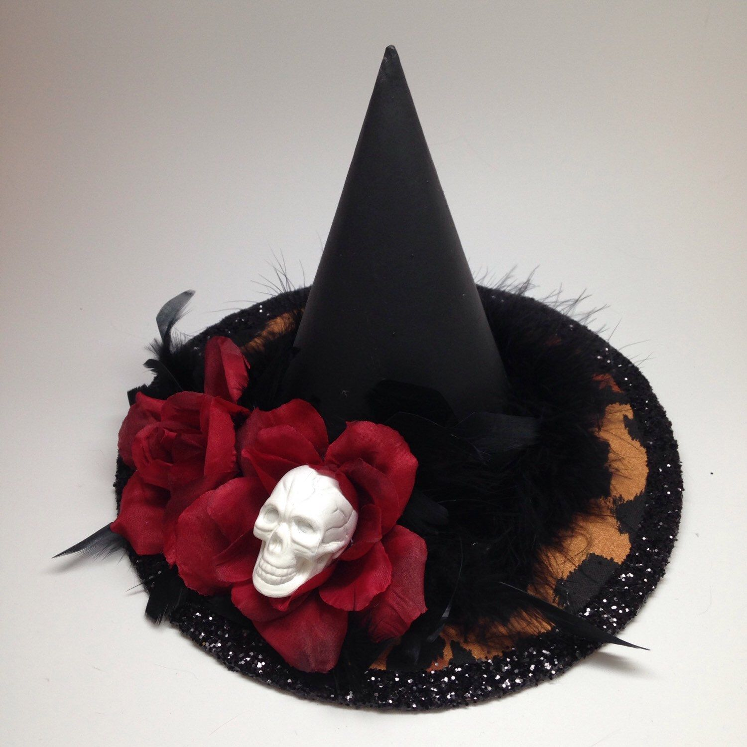 Leopard Print Halloween Home Decor Centerpiece Witch's Hat with Red Roses, White Skull and Black Feathers by SkullysSwag on Etsy https://www.etsy.com/listing/243654359/leopard-print-halloween-home-decor