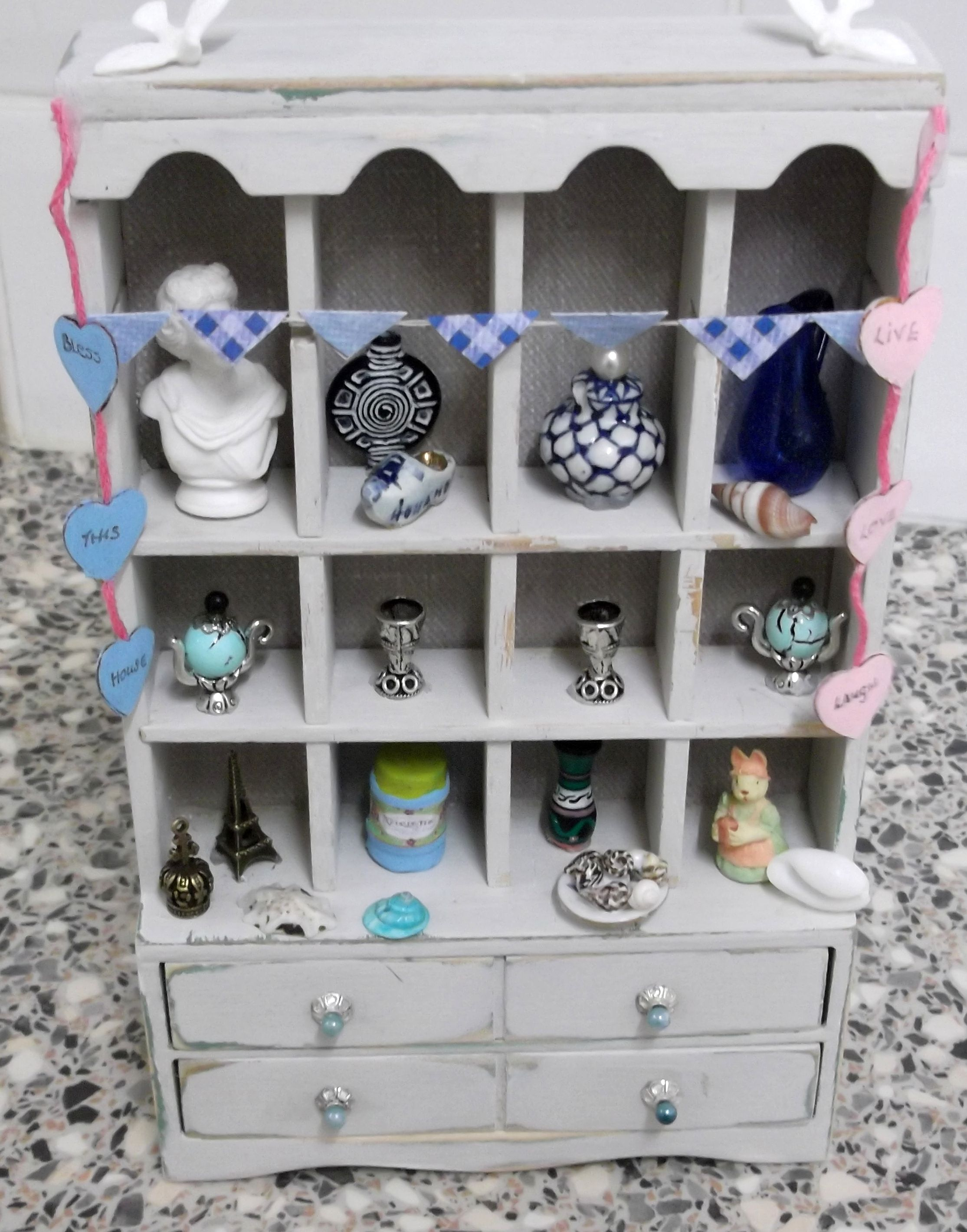 I made some of the objects on the shelves, unit distressed by |Debbie
