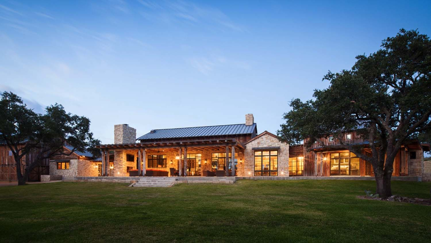 Modern rustic barn style retreat in texas hill country for Texas hill country home plans