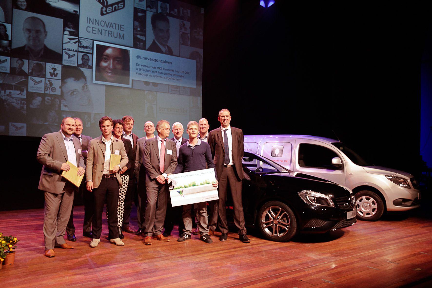 Wie staat er in 2014 prominent als winnaar in NRC Handelsblad en rijdt met in een Mercedes-Benz naar huis?