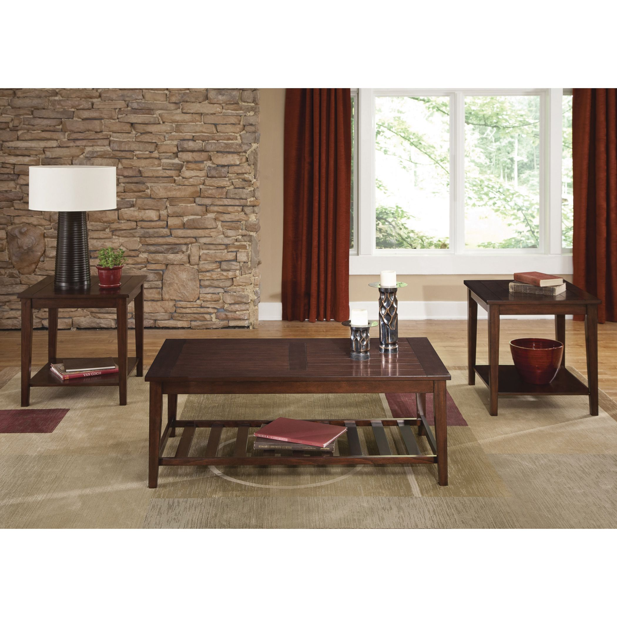 Complete your classic or modern home with this three-piece living room set from the Traditional collection by Liberty. This set includes a cocktail table and two matching end tables that are enhanced by the warm spiced rum finish.