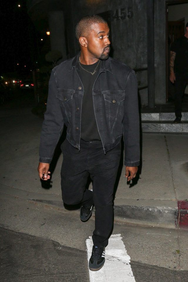 621a99e73bce6 Kanye West With Kim Kardashian Wearing Balenciaga Denim Jacket and Adidas  Samba Sneakers