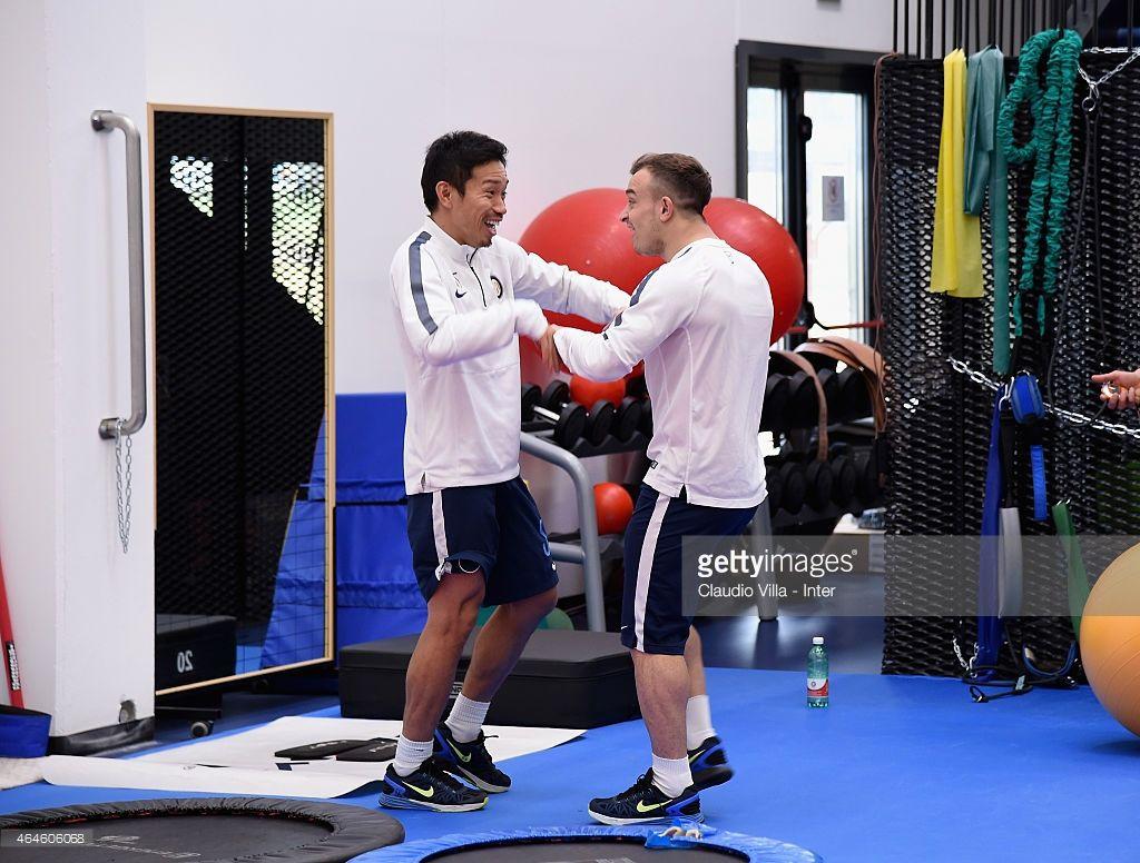 Xherdan Shaqiri (R) and Yuto Nagatomo during FC Internazionale Training Session at Appiano Gentile on February 27, 2015 in Como, Italy.