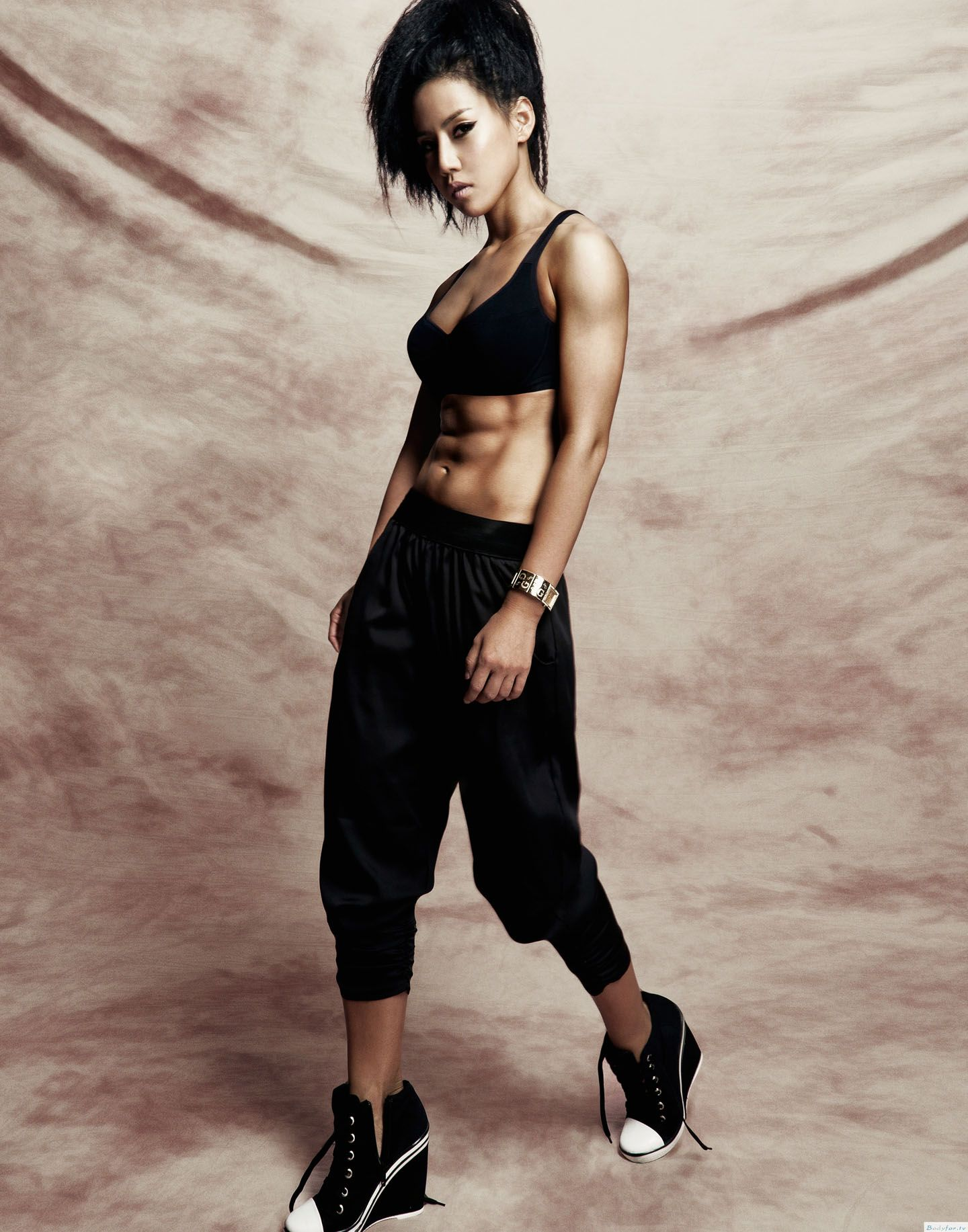 Strong asian woman posture standing and lifting up her arms and exercises muscle