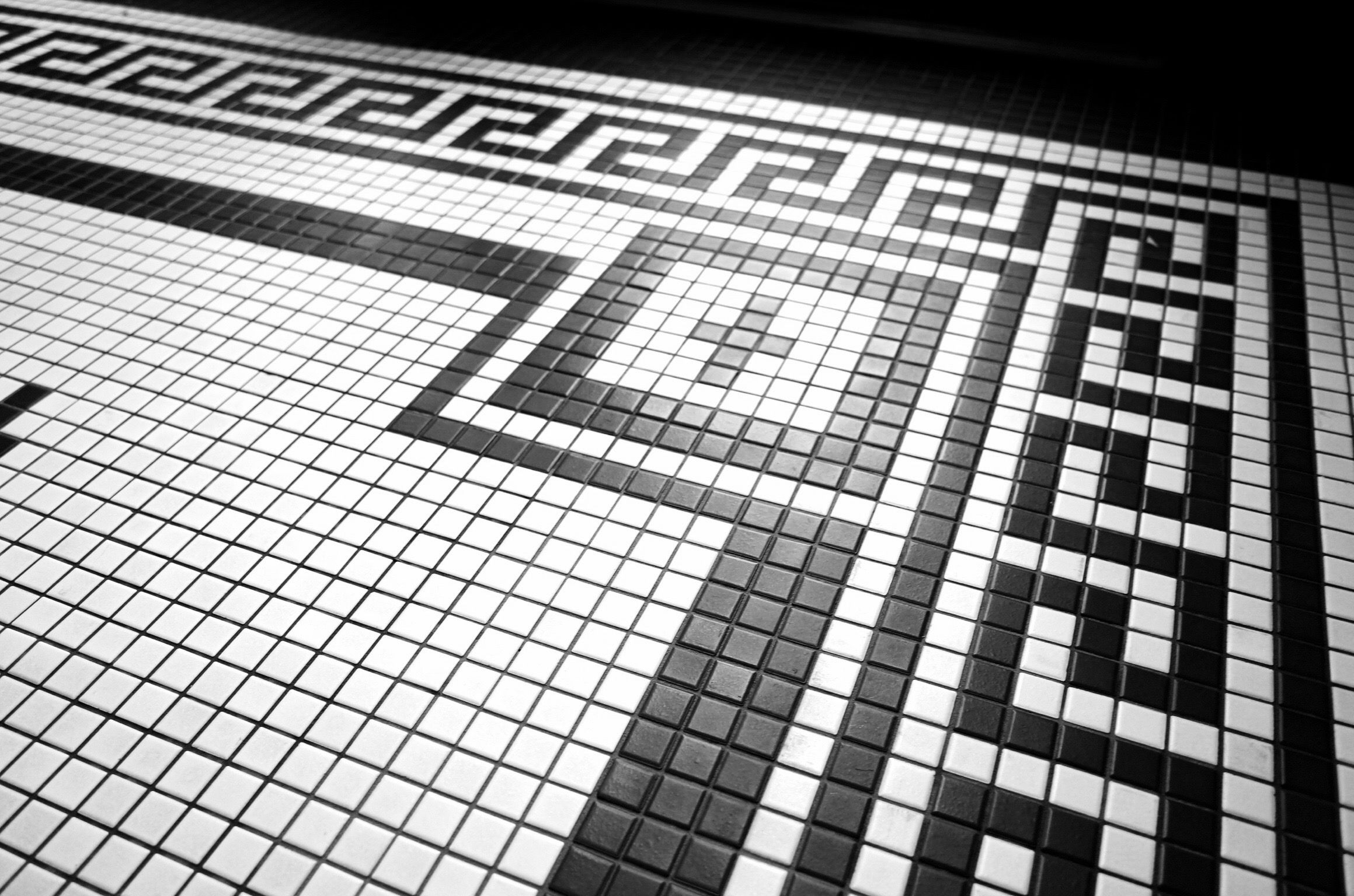 """Black and white mosaic tile. This pattern was made with 1"""" square tiles in matte black and white."""