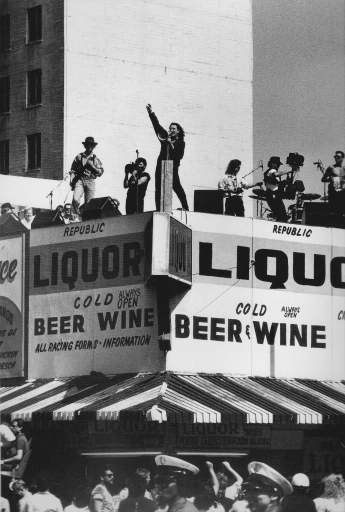U2 performing on a liquor store rooftop in Los Angeles in