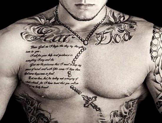 Chest Tattoo With A Celtic Cross Chain Quote And Words Fear God