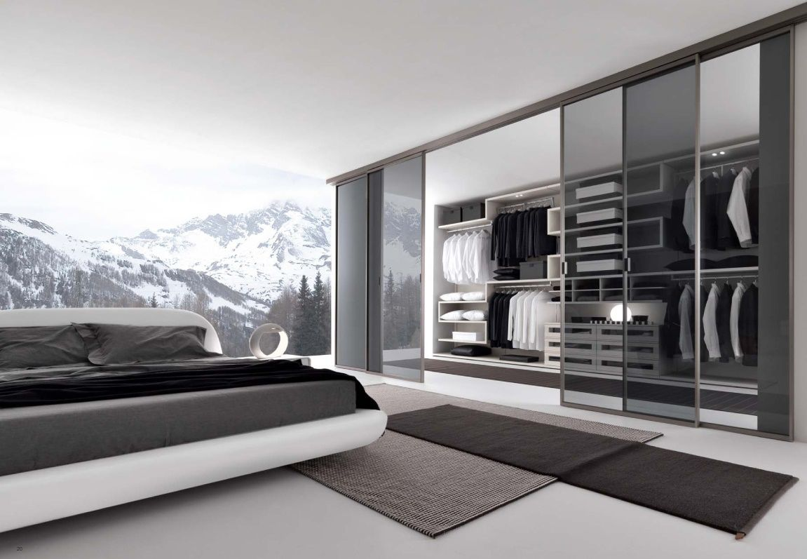 Enchanting Bedroom With Walk In Wardrobe Design Idea Presented With Transparent Wall Reflecting