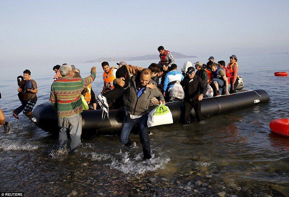 Migrants walk through Kos as 1,200 arrive on Greek islands