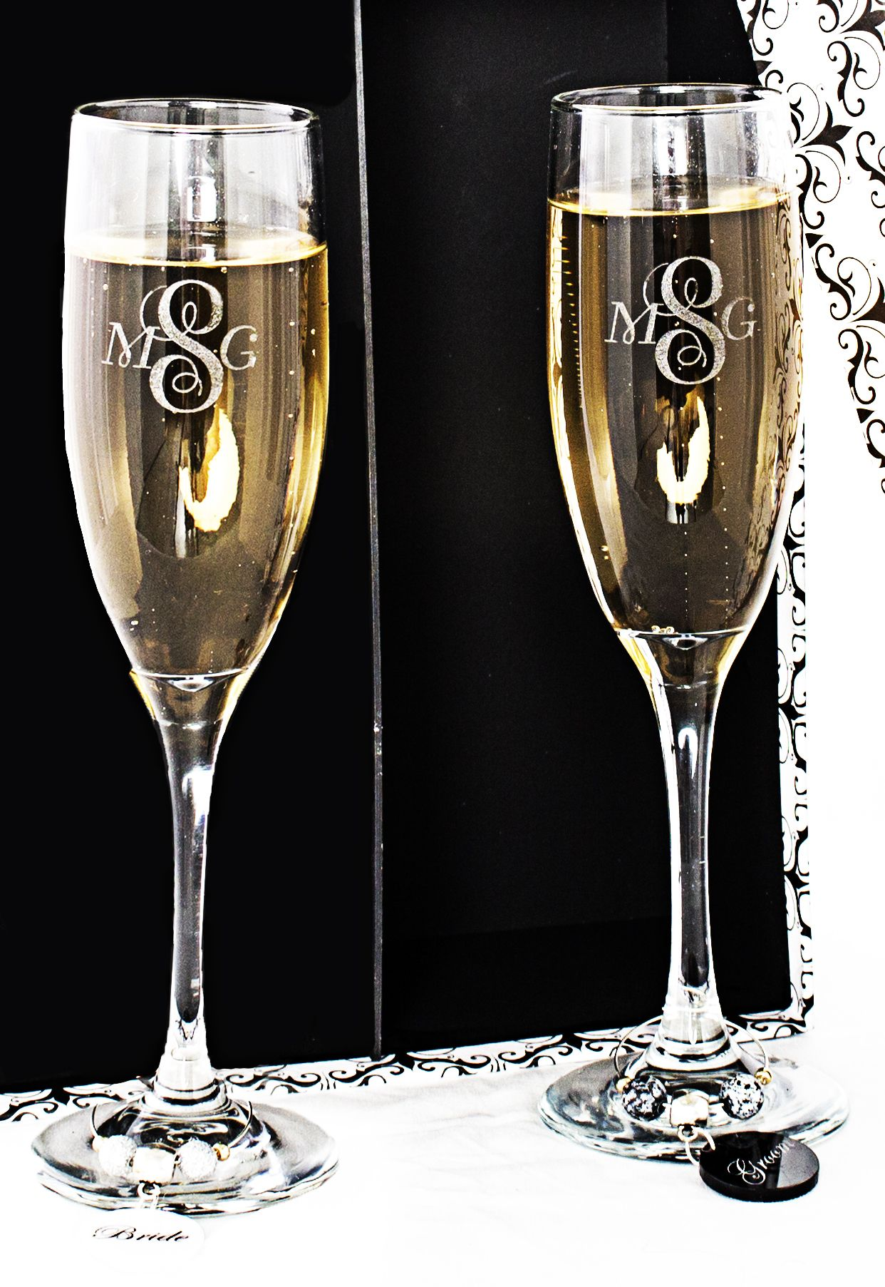 Personalized, hand crafted Monogramed Champagne Toasting Glasses for Bride and Groom