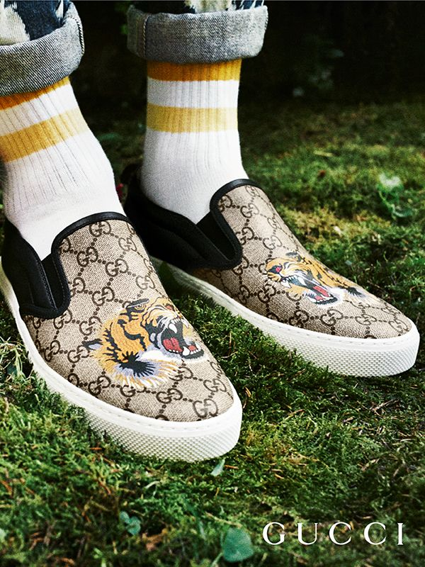 7ddc6938b74 Discover more gifts from the Gucci Garden. A tiger features on the new  men s GG Supreme canvas slip-on sneakers by Alessandro Michele.
