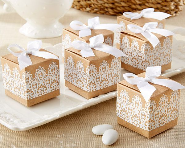 "With a mixture of rustic kraft paper and vintage lace design, these boxes are a modern interpretation of the classic favor box.  Each box comes with a white satin bow and measures 2"" x 2"" square. Sold in Sets of 24, some assembly required"
