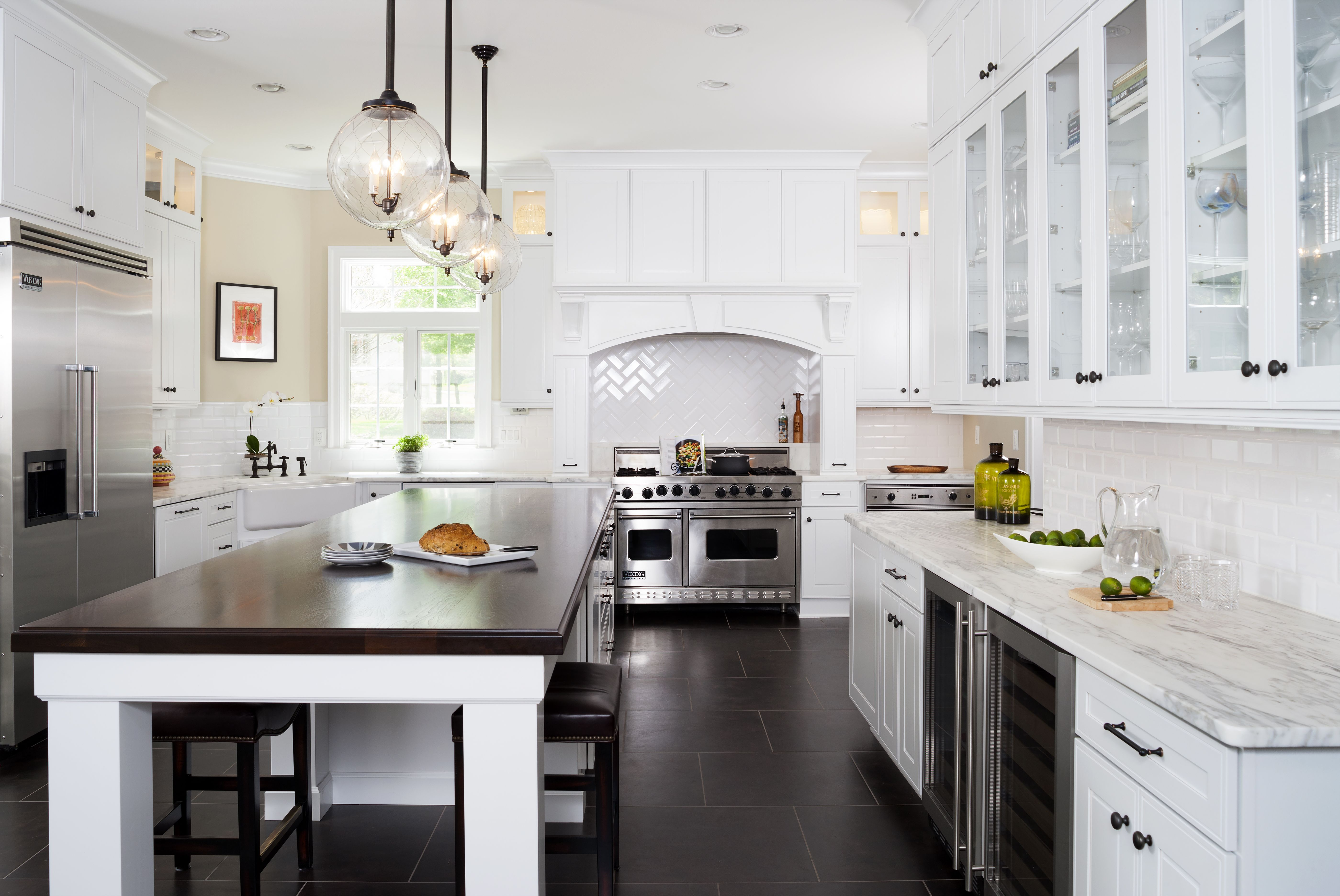 A classic white kitchen featuring Calacatta marble countertops ...