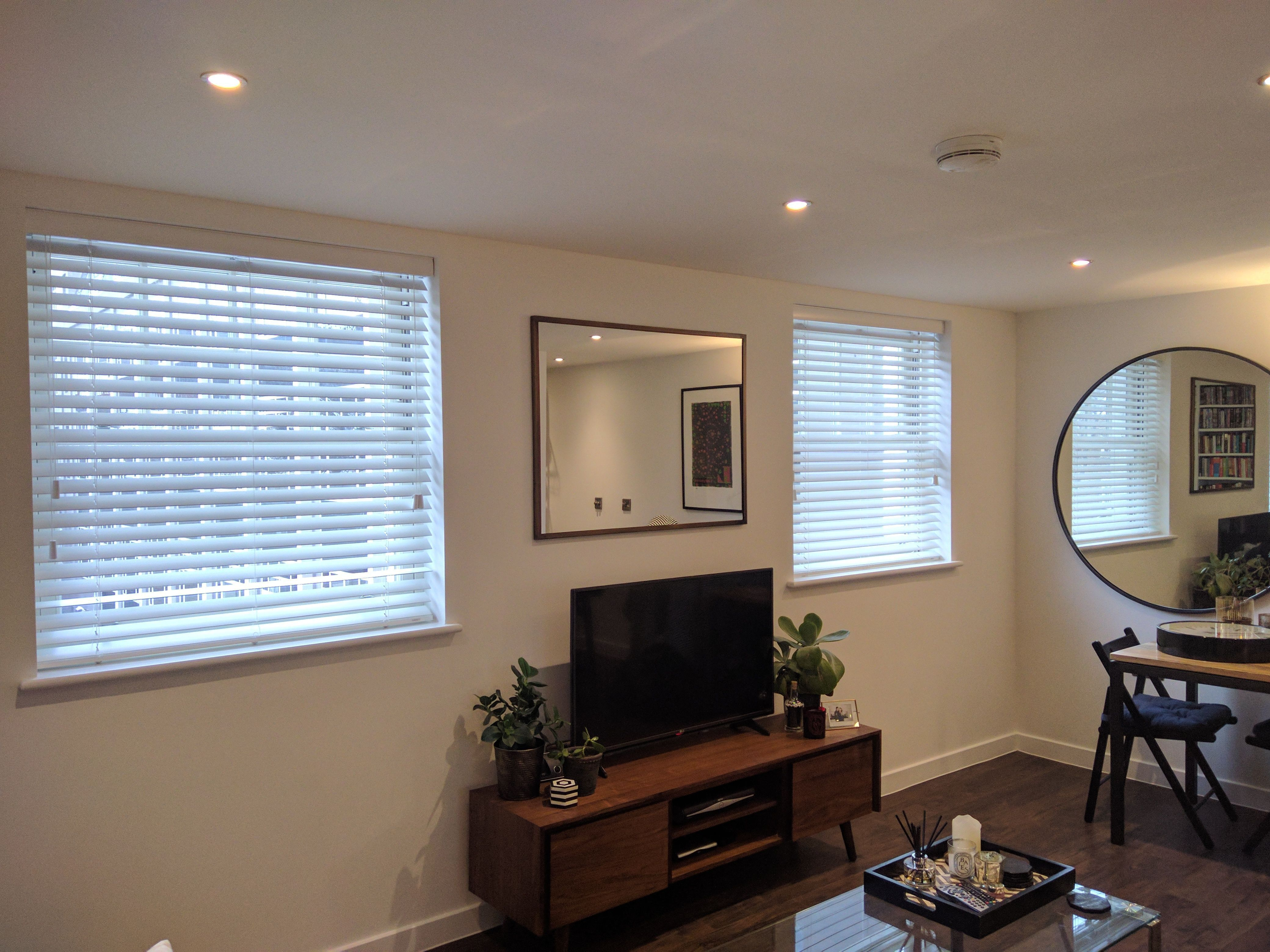 Wood venetian blinds fitted to living room windows in fitzrovia