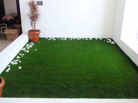 Add Artificial Grass To Indoor Spaces To Create A Warm And