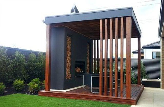 modern gazebo with a fireplace and firewood stored