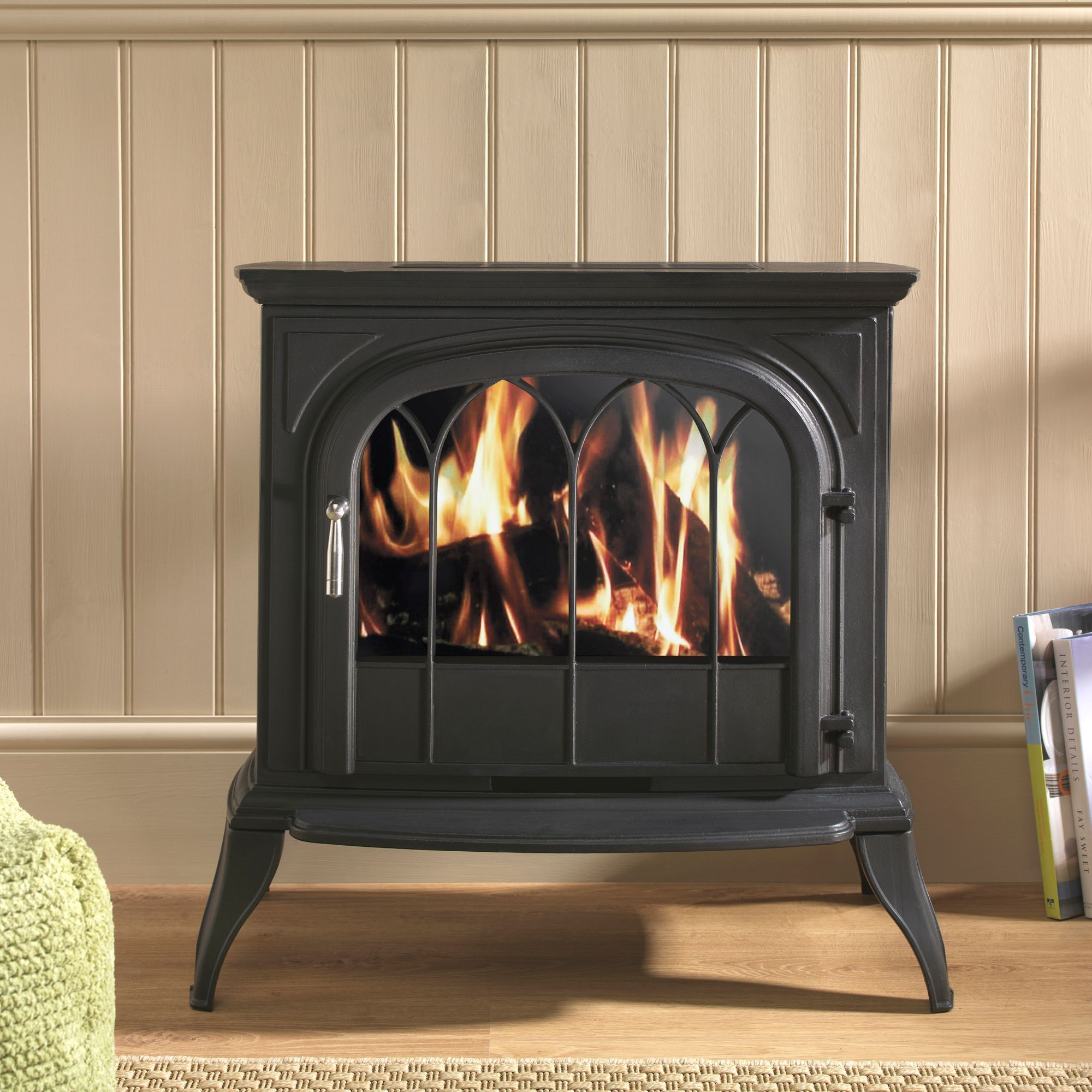 this classic black electric stove looks like a traditional log
