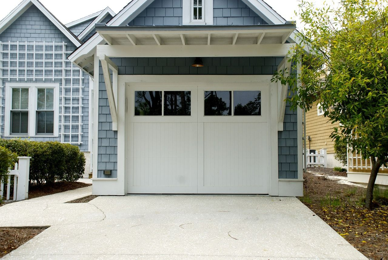 Garage Door Openers Are Something You Use Every Day But Might Take Advantage Of Check Out Our Blog Post Fo Garage Doors Garage Door Types Overhead Garage Door