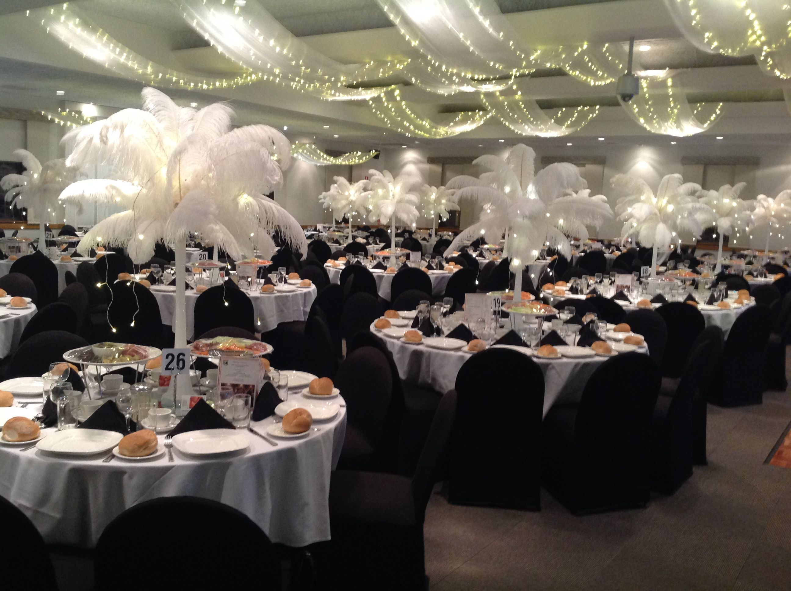 Black and white wedding themed reception with ostrich feather black and white wedding themed reception with ostrich feather centrepieces ceiling swag with fairy lighting junglespirit Image collections