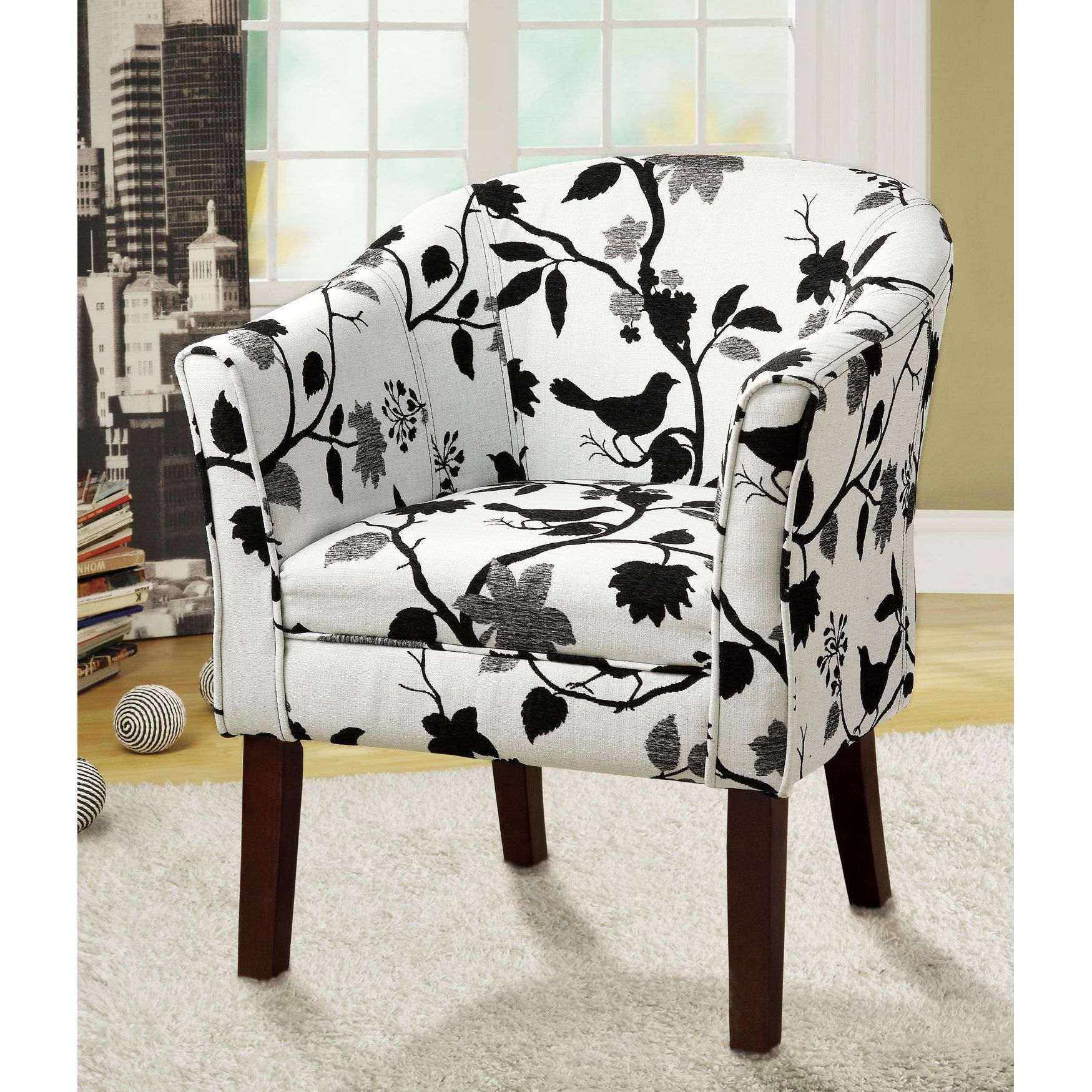 Covered in a playful bird and branch fabric this accent chair is