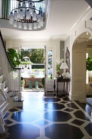 Traditional entryway with french doors, pattern stained wood floor ...