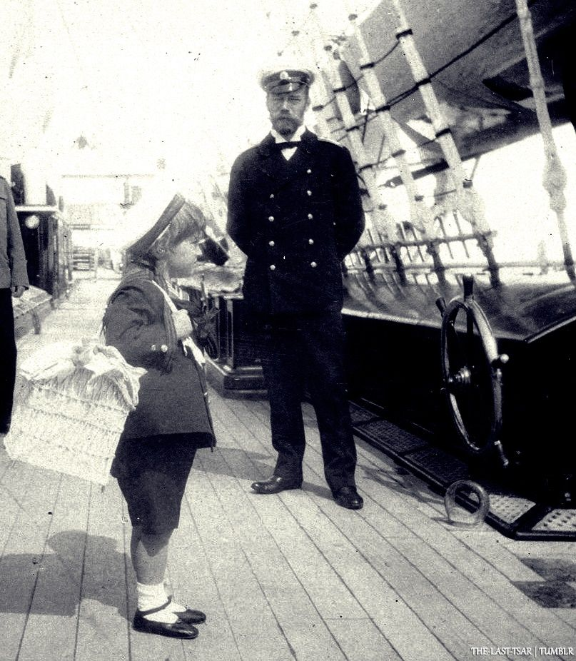 "Tsar Nicholas ll of Russia looking at his son on the Standart. ""AL"""