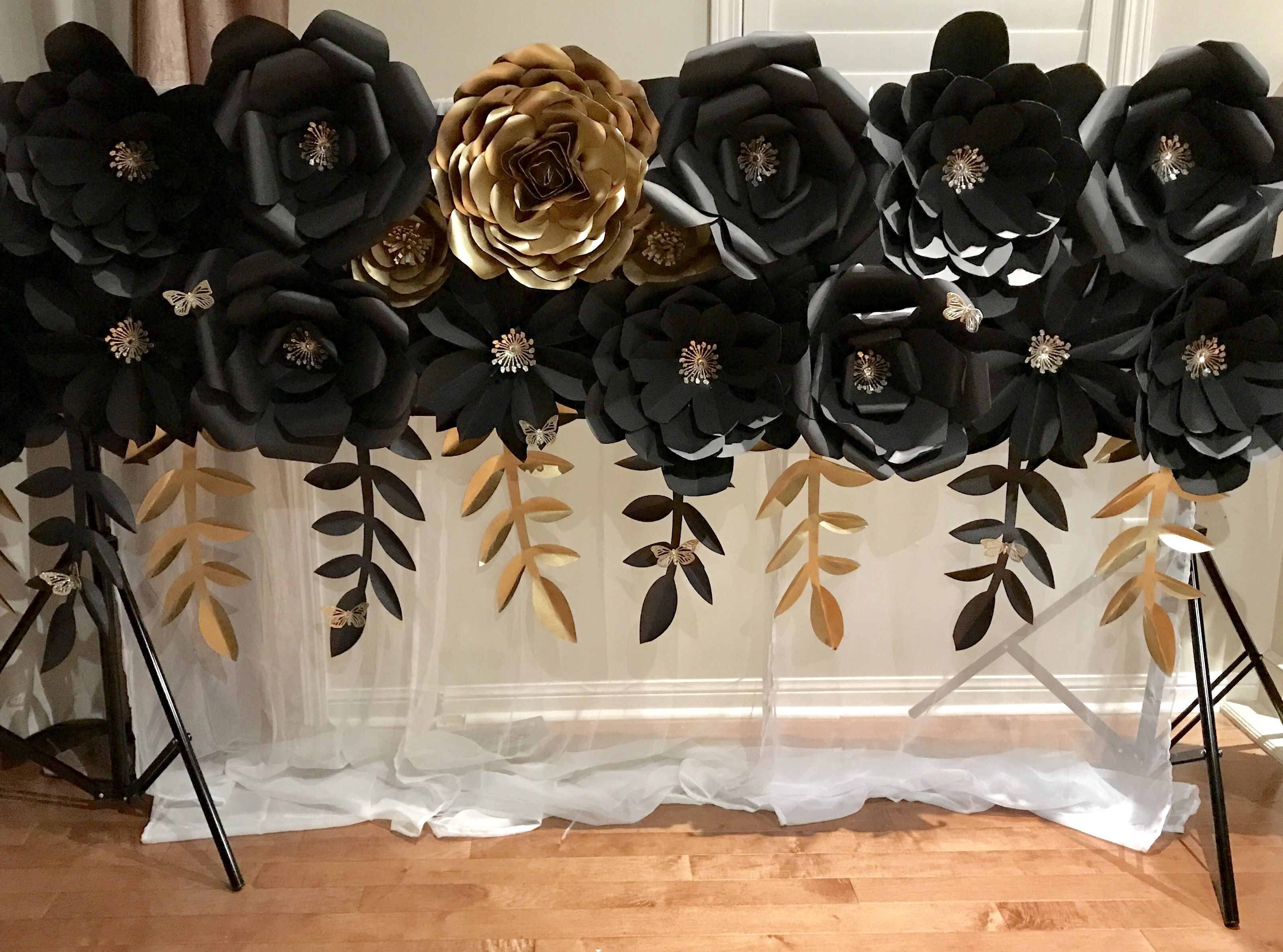 This Black And Gold Paper Flower Wall Is 8x2 With Gold Falling