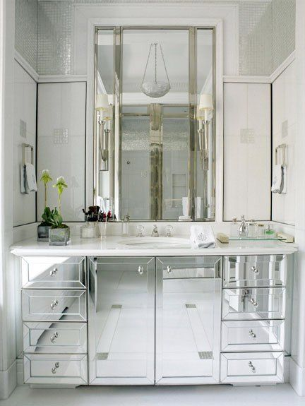 36 Mirrored Bathroom Vanity Sink | bathroom with mirrored sink cabinets and  a crystal pendant light