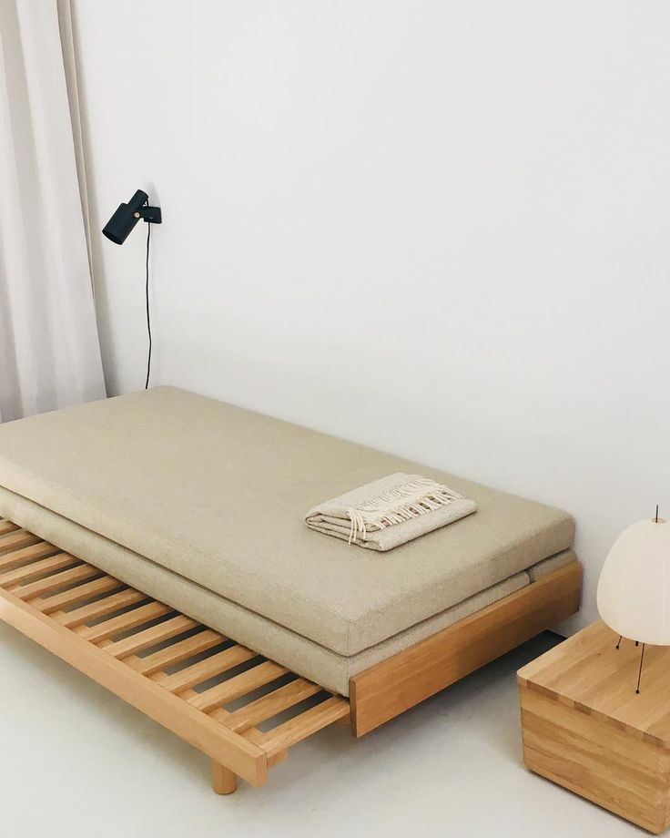Guest Bed With A Soft Beige Woollen Fabric. From Daybed To