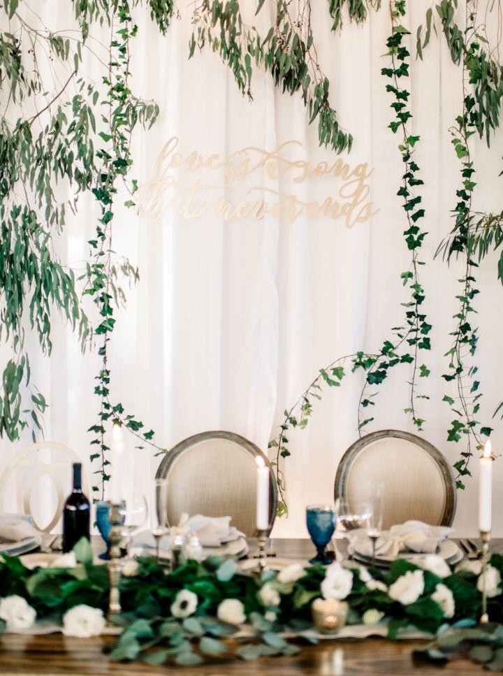 Disney-inspired wedding details - wedding quote on fabric wedding back drop #weddingdetails #weddingdecor #weddingbackdrop #fabricdraped