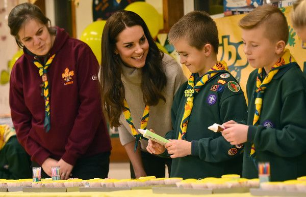 Catherine, Duchess of Cambridge ices cupcakes during an official visit to a Cub Scout Pack meeting to celebrate 100 years of Cubs on December 14, 2016 in King's Lynn, England. - The Duchess Of Cambridge Attends A Cub Scout Pack Meeting To Celebrate 100 Years Of Cubs