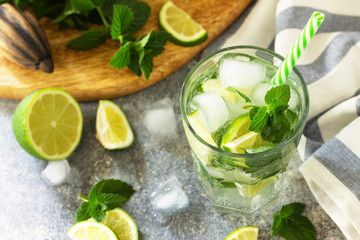 Fresh Mojito cocktail with lime, ice and mint in a glass on a gray stone background. Summer cold drink and cocktail. , #AD, #lime, #ice, #mint, #Fresh, #Mojito #Ad