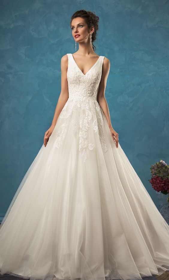 4424a77f51f21 Classic sleeveless V-neck wedding dress with lace embroidery and ballgown  skirt; Featured Dress: Amelia Sposa